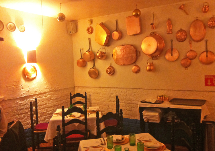 Vintage copperware adorns the walls at Fonda el Refugio in Mexico City.